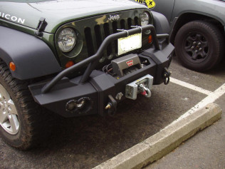 Jeep Wrangler with off-road steel bumper and winch